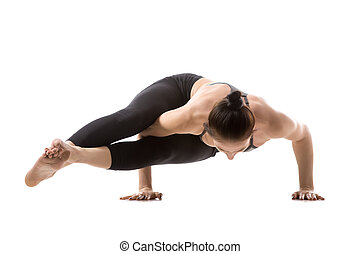 Handstand, Astavakrasana pose - Sporty fit beautiful young...