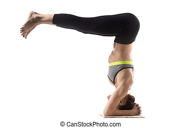 Headstand Half Fold - Sporty fit beautiful young brunette...