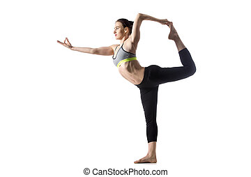 The Dancer pose - Sporty fit beautiful young brunette woman...