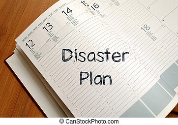 Disaster plan write on notebook - Disaster plan text concept...