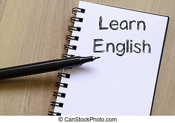 Learn english write on notebook - Learn english text concept...