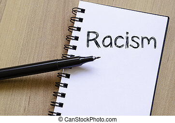Racism write on notebook - Racism text concept write on...
