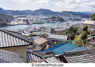 Tiled roof buildings and industrial area of the seashore...