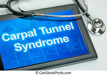Tablet with the diagnosis Carpal Tunnel Syndrome on the...
