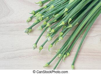 onion flower on wooden board