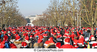 of people dressed as Santa Claus during the foot race -...
