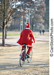 Santa uses the bike instead of the slide in the avenue...
