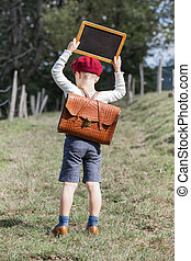 School Boy and his Chalkboard - Young school boy in vintage...