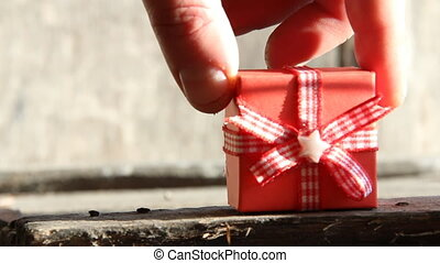 red gift box - Gift box on gray wooden background