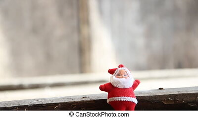 Gift box and Santa Claus on a gray background