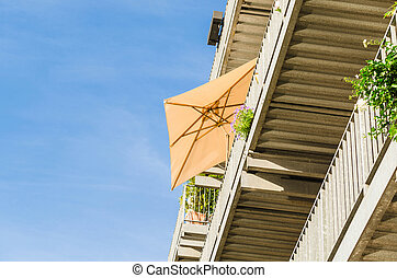 Sunshade on a terrace, view from below.