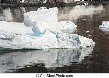 Iceberg Drifting In The Ocean