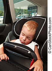Boy and car seat safety.
