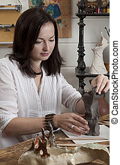 Woman sculpts from raw clay - Woman shaping clay sculpture...