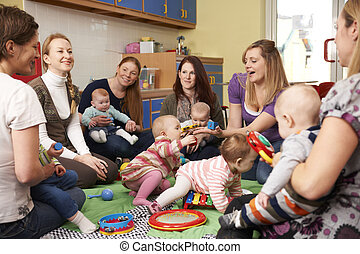 Group Of Mothers With Babies At Playgroup