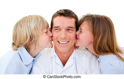 Cute siblings kissing their father against a white...