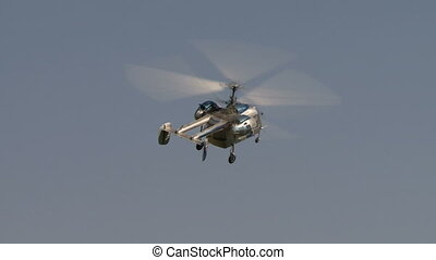 View of flying helicopter turns at camera - Close-up of...