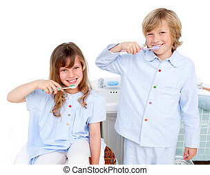 Cute children brushing their teeth at home