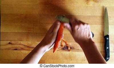 Cleaning orange carrot, meal preparation