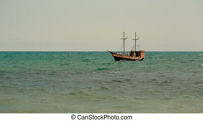 Old Ship in the Sea - Old ship sails at sea
