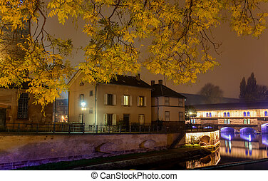 Night city of Strasbourg , the promenade in autumn yellow...