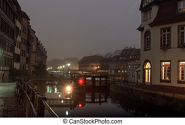 Night city, houses located on the banks of the River autumn...