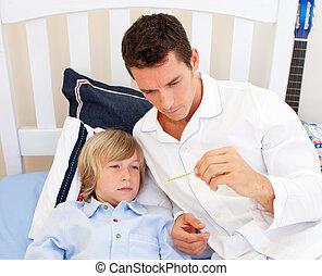 Portrait of an attractive father checking his son\'s...