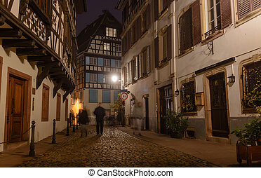 Night old city cobblestones lonely passers street lighting...