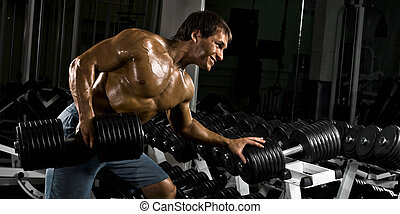 bodybuilder - very power athletic guy , execute traction...