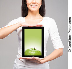 Beautiful, young brunette holding a tablet over isolated...
