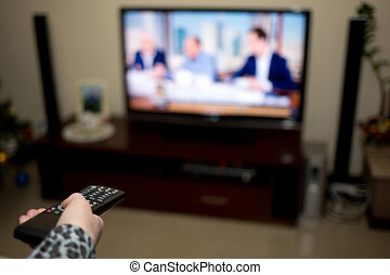 Tv and hand pressing remote control - LCD Tv and hand...