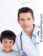 Portrait of a little boy and his doctor