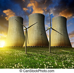 energy concept - Nuclear power plant with wind turbines in...