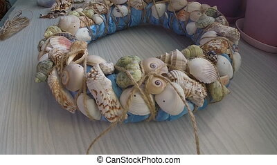 Trim the ends of the rope on decorative wreath Hand made