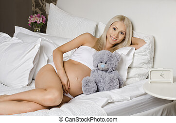 pregnant girl - happy young pregnant woman lie in bed, in...