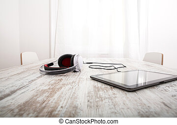 Tablet PC and headphones - A Tablet PC with headphones on...