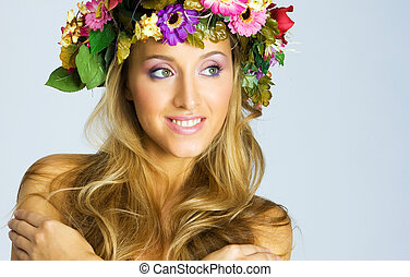 Pregnant girl with flower wreath