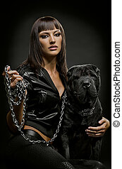 sexy woman with dog - the beautiful young woman sit with dog...
