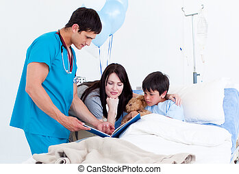 Attentive little boy, his mother and a doctor having a talk...