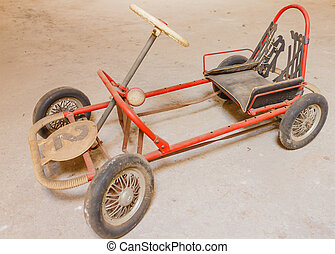 an old go-kart for children - close-up of an old go-kart for...