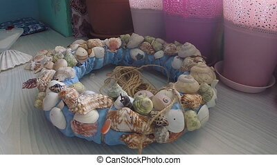 Bonding seashells on decorative wreath