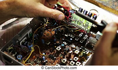 Soldering Electronics on Circuit Board - Close-up of male...