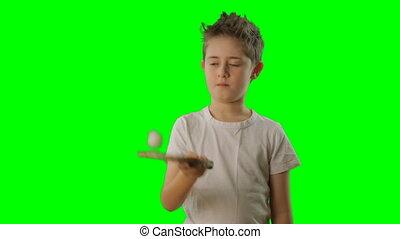 Kid juggles the ping pong ball Green screen - Boy juggles...