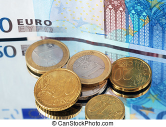 European currency coins and banknotes on mirrored surface