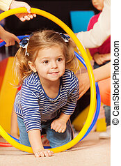 Portrait of a girl go though hoop in active game - Portrait...