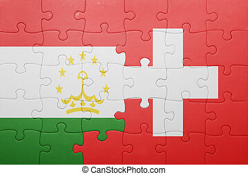 puzzle with the national flag of switzerland and tajikistan...