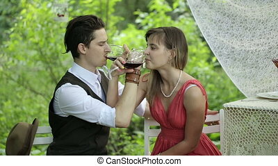 Couple Drinking Wine - Happy couple drinking wine in the...