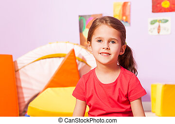 Portrait of girl in kindergarten room