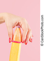 Put on a condom. - Female hand with red fingernails puts on...