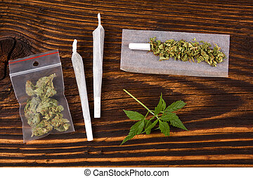 Marijuana background Cannabis joint, bud in plastic bag and...